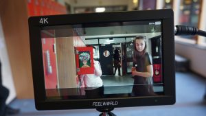 View of camera filming pupils from St Paul's RC High School in Glasgow and its feeder primary schools as they create a film about education in 2030.
