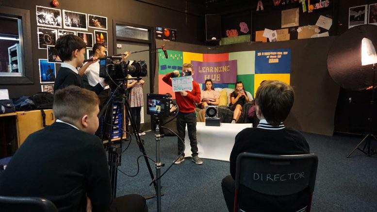 View of pupils from St Paul's RC High School in Glasgow and its feeder primary schools filming a short film about education in 2030.