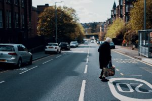 Woman crossing the road in Glasgow