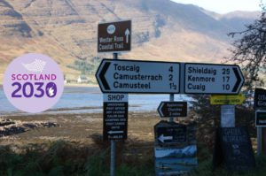 View of signposts pointing in different directions on Applecross